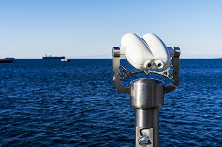 Tourist binoculars at sea pointed at sea.