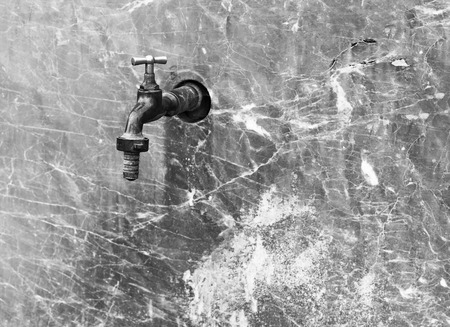 Closed water faucet on a marble wall with Stok Fotoğraf - 120368623