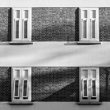 White windows on a building made from bricks with symmetry. Stok Fotoğraf - 120368626