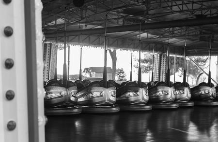 Amusement park bumper cars in a line. Stock Photo