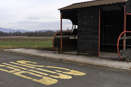 Bus stop in the middle of nowhere. Stok Fotoğraf - 120368698