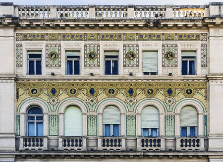 Trieste, Italy, EU - Yanuary 3, 2019: Detail of the mosaic facade of Palazzo della Prefettura with coats of arms of the Savoy house created after the First World War