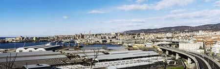 Trieste, Italy, EU - Yanuary 3, 2019: Panoramic view of a big port and industry located in Italy. 新闻类图片