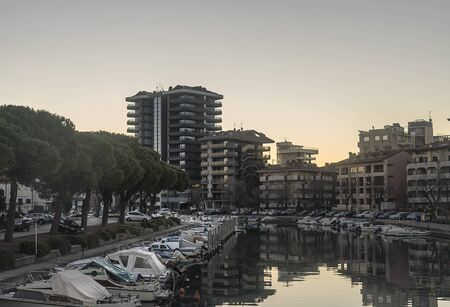 Grado, Italy, EU - January 2, 2019: Small fishing boats parked in a mediterranean sea canal.