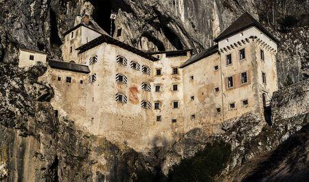 Predjama castle build into rock wall, located in Slovenia.