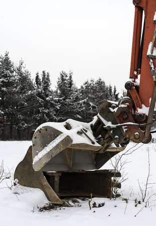 Small excavator part covered with some snow in winter time. Stok Fotoğraf - 120368820