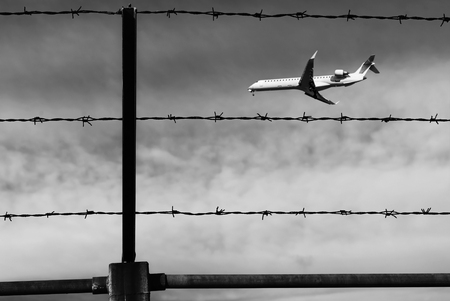 Airplane is blurred behind a fence. Stok Fotoğraf - 120368832