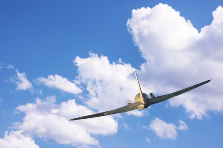 Older type of airplane is flying high in the sky. Stok Fotoğraf