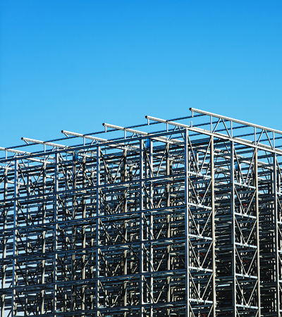 Construction site with a metal structure frame being built. Stok Fotoğraf
