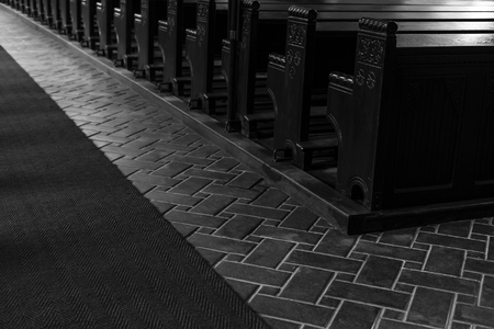 Empty wooden church benches of a Christian church