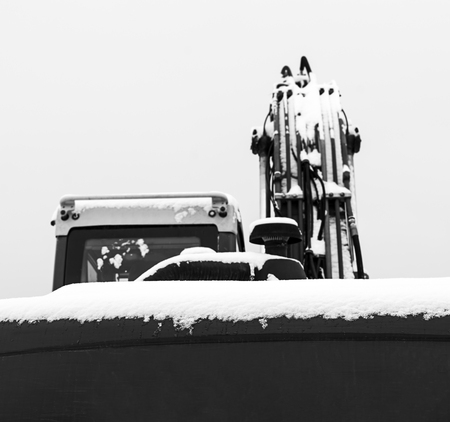 Excavator machine covered with some snow in winter time. Stok Fotoğraf
