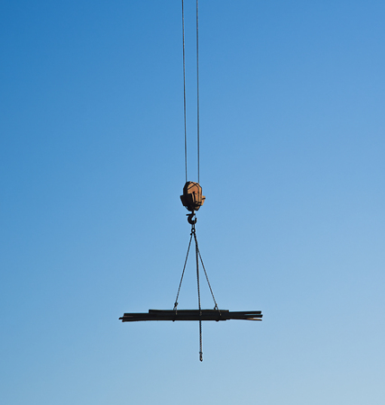 Hanging hook over the construction site with some wooden boards. Stok Fotoğraf