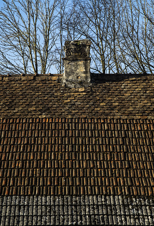 Old house with three kind of roof tiles covered on it.