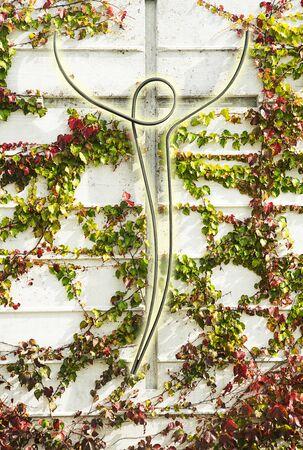 Metal rod shaped like a human with a concrete cross shape behind 版權商用圖片