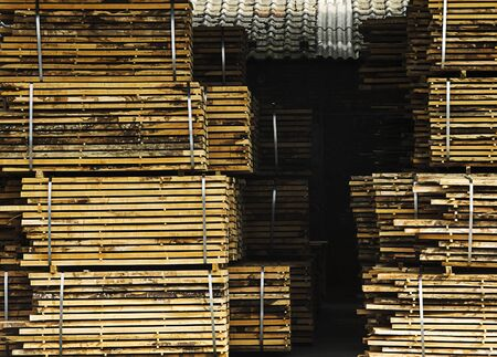 Processed lumber packed and stacked and drying on air.