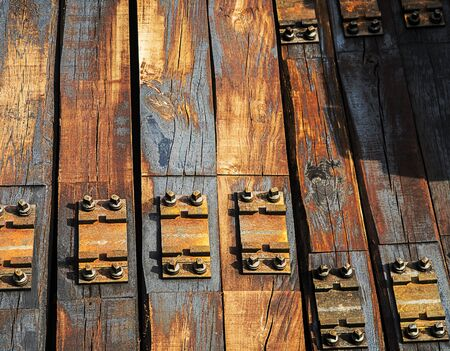 wooden logs for train railroad stacked on a pile.