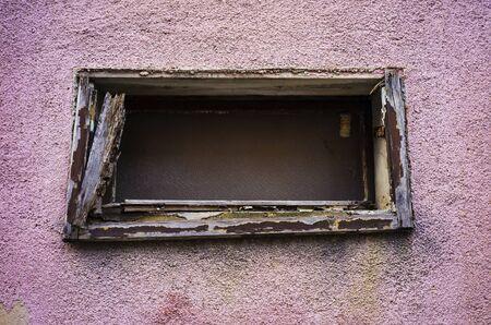 Old window is falling apart.