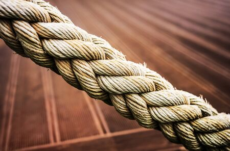 Strong rope with a vibrant background in the back.