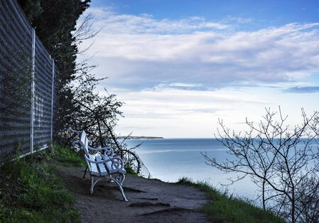 Small bench on a isolated place with a mediterranean sea view. 版權商用圖片