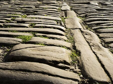 Old road pavement with layed stones from medieval times.