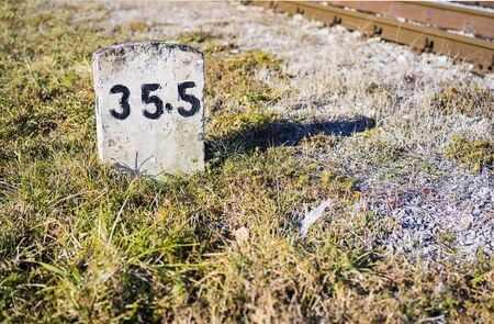 Railroad stone mark with a number.