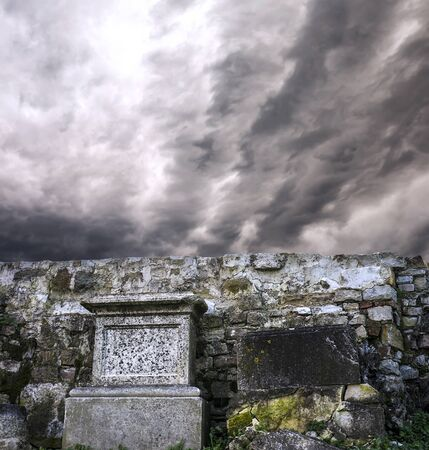 Gravestones with dramatic clouds scene behind