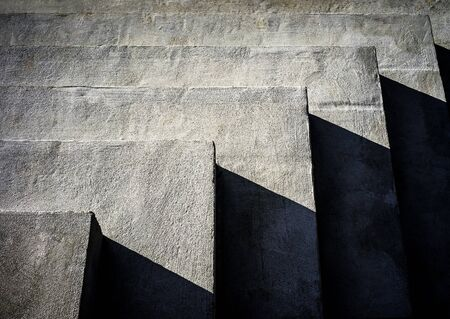 Long concrete steps with some harsh shadows
