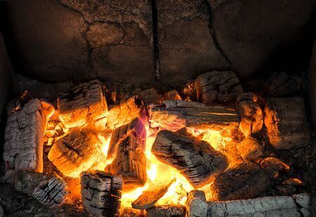 Fireplace full of glowing burning wood