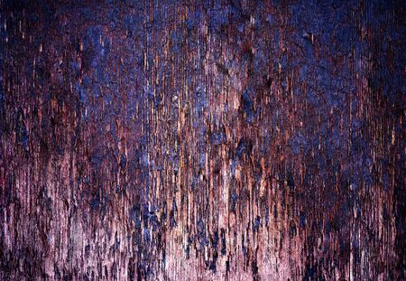 Damaged wood plank close up texture with purple and pink tones. 免版税图像