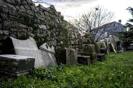 Abandoned cemetery old cement gravestones 版權商用圖片