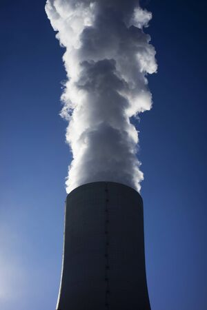 Big and toxic smoke that comes from an industrial chimney. Stok Fotoğraf