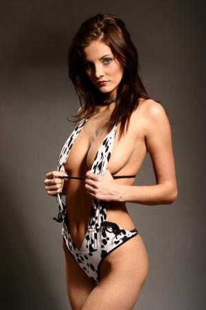 Brunette woman posing in sexy swimsuit