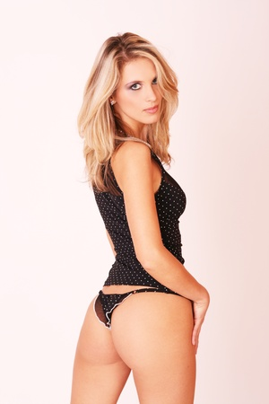 Sexy blonde woman in black lingerie on white background  Stock Photo