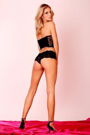 Beautiful slim woman posing in black lingerie