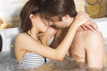 Passion couple kissing in the jacuzzi Stock Photo - 12371097