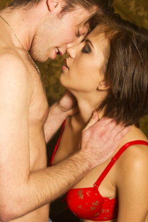 Passion couple kissing in lingerie Stock Photo