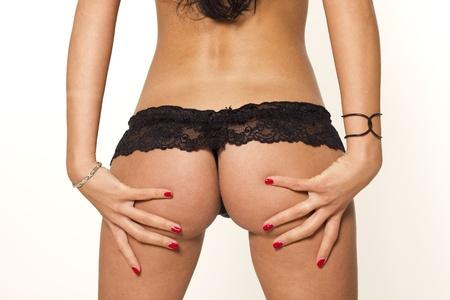 mujeres eroticas: Culo sexy mujer en ropa interior sobre fondo blanco aisladas Foto de archivo