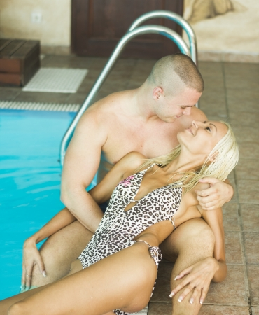 Sexy passionate heterosexual couple by a pool photo