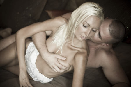 Sexy passionate heterosexual couple in bed Stock Photo - 14531098
