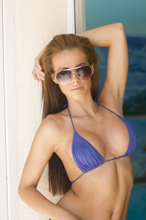 Beautiful brunette woman in blue bikini photo