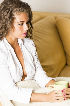 Young beautiful brunette woman in the bed with coffee  photo