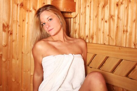Sexy blonde woman in the sauna photo