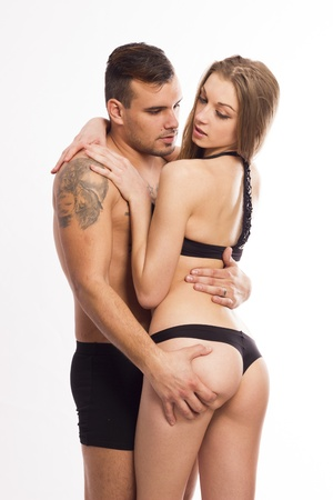 Sexy young passion couple on white isolated background