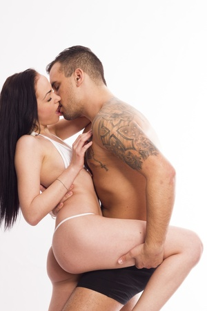 Sexy young passion couple on white isolated background photo