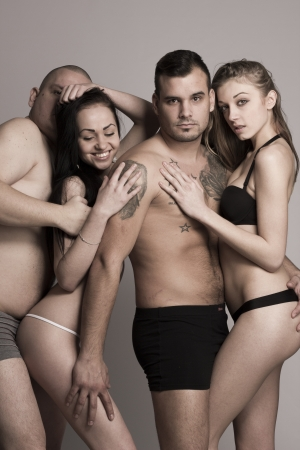 Swinger foursome in lingerie - desaturated photo