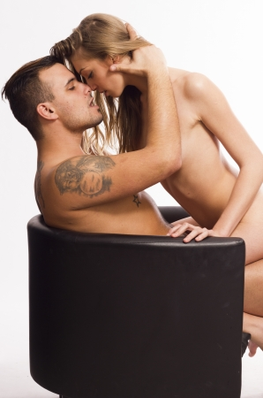sex couple: Sexy young passion couple emracing on white isolated background