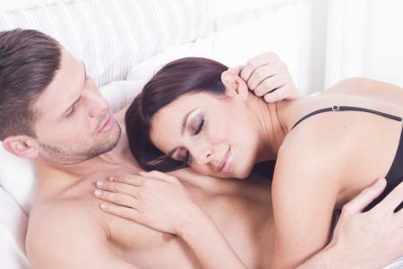 Sexy passionate heterosexual couple in bed Stock Photo
