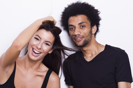 Young cheerful interracial couple on white isolated background photo