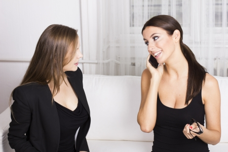 Two beautiful businesswomen in discussion Stock Photo