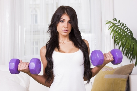 Sexy beautiful woman doing training exercise at home Stock Photo - 20241043